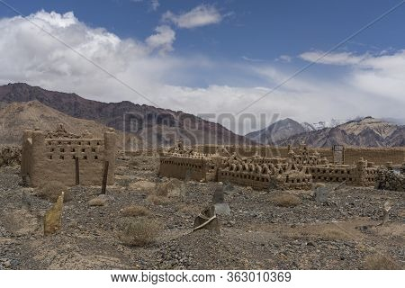 Murghab, Tajikistan - June 26, 2019: Graveyard With Old Abandoned Mud Graves And Tombs In Murghab In