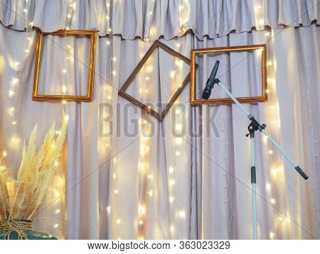 A Small Studio With A Microphone For Musicians. Against The Background Of Curtains With Garlands And