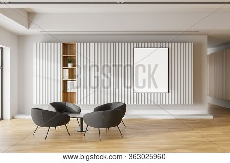 Interior Of Modern Office Waiting Room With White And Wooden Walls, Wooden Floor, Comfortable Grey A