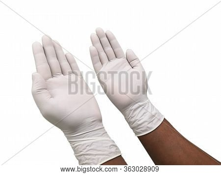 Hands Putting On Protective White Gloves. Latex Gloves As A Symbol Of Protection Against Viruses And