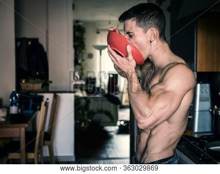 Hungry Shirtless Guy Having Breakfast At Home