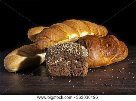 Freshly Baked Wheat Bread, Still Life With Bread, Crisp Loaf Of Bread, Still Life On A Rustic Backgr