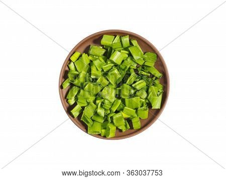 Chopped Green Onion On Brown Clay Plate Isolated On White. Healthy Eating, Ayurveda, Naturopathy Con