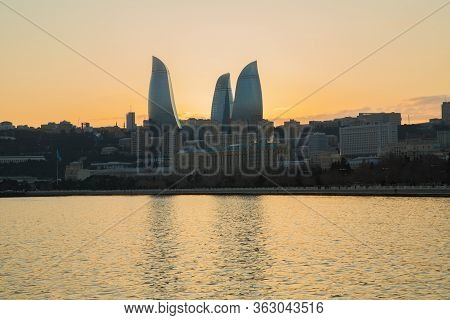 Night View Of Baku And The Seaside Of The Caspian Sea. Sunset In Baku. Colorful Sunset On The Baku B