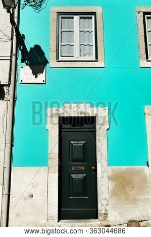 Old Colorful And Beautiful Facades With Vintage Streetlight In Lisbon Streets In Spring.