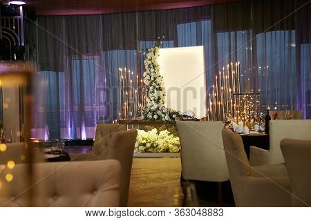 A Banquet Room And A Table Of The Newlyweds Decorated With A Bouquet Of Beautiful Fresh White Flower