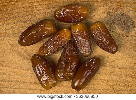 Various Dates On A Wooden Board. The Fruit Of The Palm Tree, Called, Date, Is Widely Used In The Mag