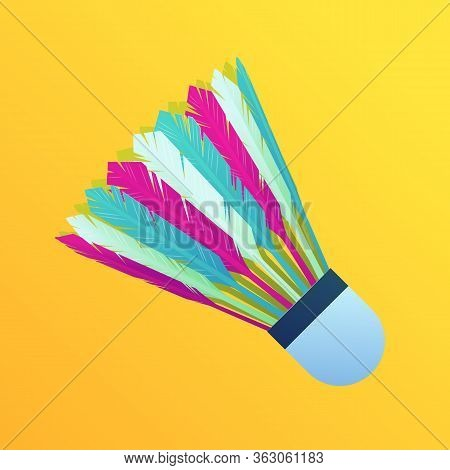 Colorful Feather Shuttlecock Isolated On Yellow Background. Sports Equipment For Badminton Game. Bri