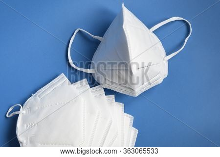 White Kn95 Or N95 Mask For Protection Against Coronavirus. Surgical Protective Mask. Prevention Of T