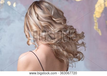 Perfect Blonde, Beautiful And Well-groomed Blonde Hair. Long Curls, Back View