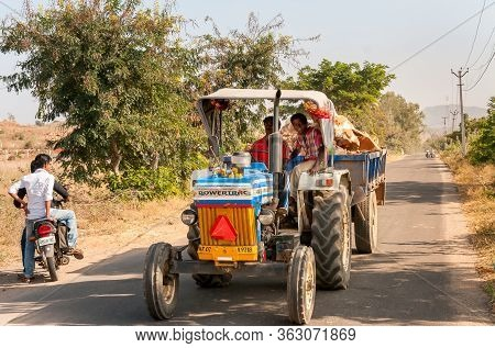 Indian Workers On The Tractor Transport The Wood, Puttaparthi Village, India