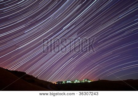 The accumulated star trails above the IBM Almaden Research Center in San Jose California. poster