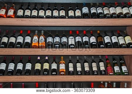 Sao Paulo, Brazil - August 10, 2019. Several Bottles Of Wine For Sale Displayed On Shelves From A Wi