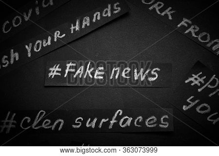 Fake News. The Name Is Written In White Chalk On A Black Background In The Form Of Paper. Coronaviru