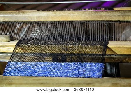 A Loom With Accessories Threads, Wool, Boat.