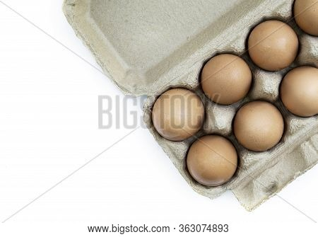 Close Up Brown Chicken Egg In Paper Box