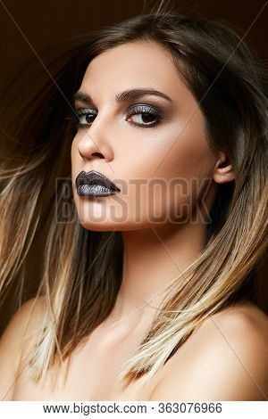 Portrait Of A Young Brunette With Expressive Eyes And Dark Makeup On Her Face.