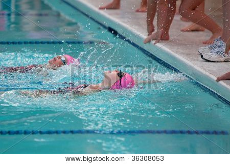 Youth Swimmer Reaches For Wall During Swim Meet