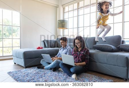 Three Members Of Diverse Family, Caucasian Father, Asian Mother And Little Half Daughter Spend Time