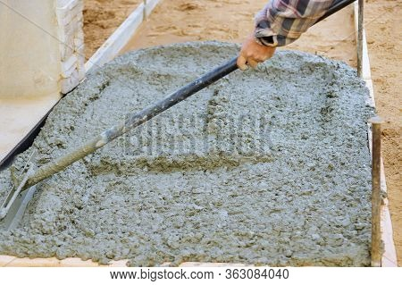 Making Of Freshly Poured Cement On Concrete Pavement Sidewalk In New Residential Home