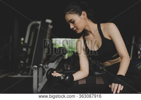 Strong Pretty Asian Slim Body Woman In Black Sport Bra Exercise With Dumbbell In Fitness Gym In Back