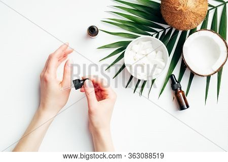 Female Hands Applying Coconut Oil For Hand Skin Moisturizing. Flat Lay Composition With Woman's Hand