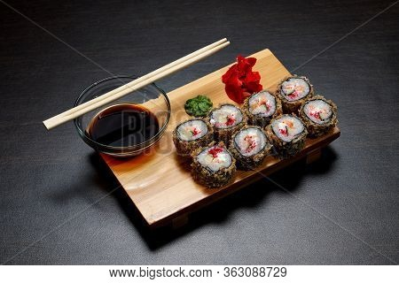 Tasty And Delicious Hot And Cold Sushi Rolls On The Table. Different Sushi - Rolls With Sauce On The