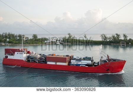 The Early Morning View Of A Loaded Cargo Ship Passing By Along Paradise Island Inside Nassau Harbour