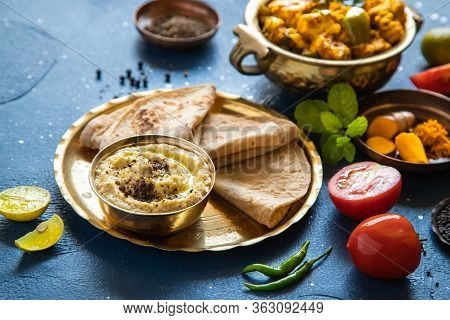 Oriental Food - Indian Homemade Bread Chapati And Sauce. Indian Cuisine. Indian Curry In Copper Bras