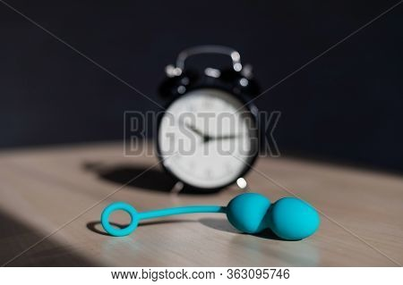 Alarm Clock And Vibrator On The Table. Time For Training Intimate Muscles. Vaginal Balls Strengthen