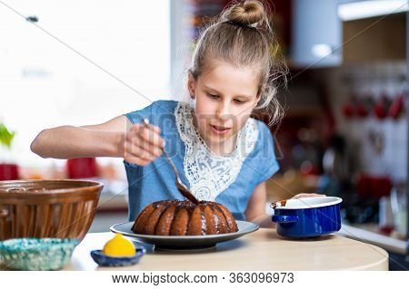 Young Kid In Blue T-shirt Is Making, Easy To Prepare And Healthy, Home Made Easter Cake - During Sta