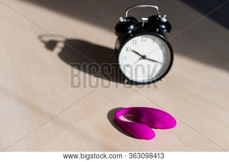 Time For Carnal Pleasures. Alarm Clock And Stimulator G Spot. Pink Vibrator For Masturbation.
