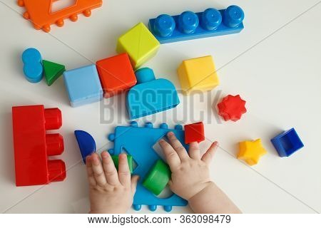 Children Playing With Montessori Toys, Educational Toys, Arranging And Sorting Colors And Sizes.