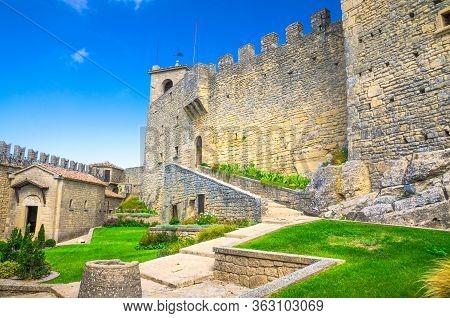 Republic San Marino, September 18, 2018: Courtyard With Green Grass Lawn Of Prima Torre Guaita First