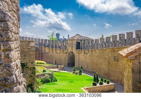 Republic San Marino, September 18, 2018: Stone Brick Fortress Wall With Merlons And Courtyard Of Pri