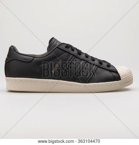 Vienna, Austria - February 14, 2018: Adidas Superstar 80s Black Sneaker On White Background.