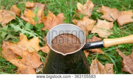 Brewing Coffee In A Turkish Pot - Outdoors Over The Autumn Leaves