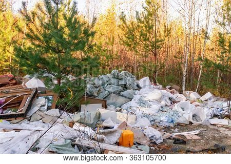 Garbage Dump In The Forest. People Illegally Thrown Garbage Into Forest. Concept Of Man And Nature.