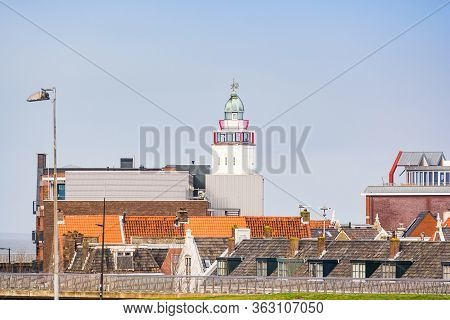 Harlingen, Netherlands - January 10, 2020. Tower Of Lighthouse With Cityscape