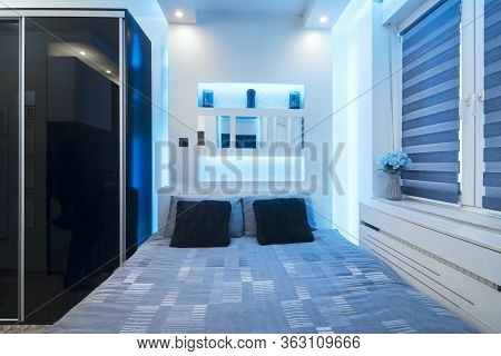 Lovely Little Bedroom In Little Apartment With Blue Lighting, Modern Living Or Domestic Life At Home