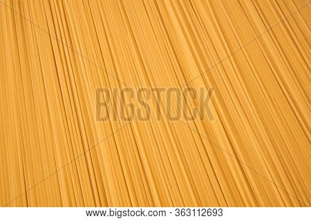 Background Of Dry Uncooked Spaghetti Pasta Close-up