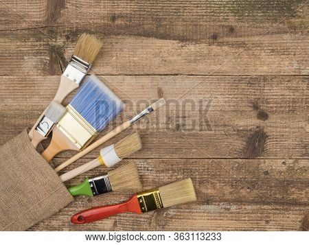 The Brush Of A Painter To Repair On Wood Background.. Painting Supplies. The View From The Top. Brus