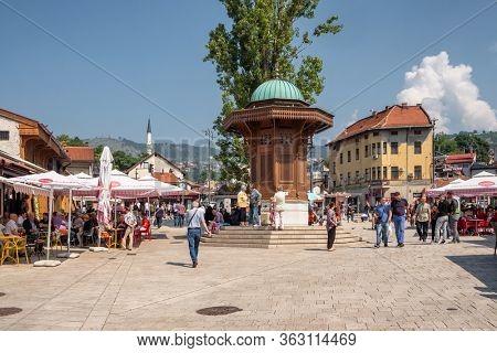 Sarajevo, BiH - August 27, 2019: Bascarsija square with Sebilj wooden fountain in Old Town Sarajevo in Bosnia and Herzegovina