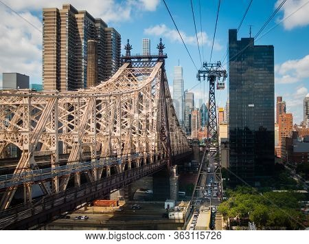 Midtown Manhattan And Ed Koch Queensboro Bridge From Roosevelt Tramway With Cables Visible. Sunny Da