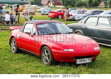Moscow, Russia - July 6, 2012: Red Sports Car Mazda Eunos Roadster Presented At The Annual Motorshow