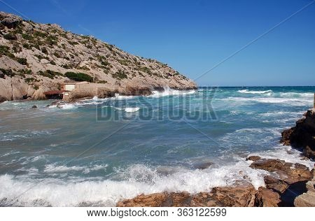 Rough seas at Cala Barques in the resort of Cala San Vicente on the Spanish island of Majorca.