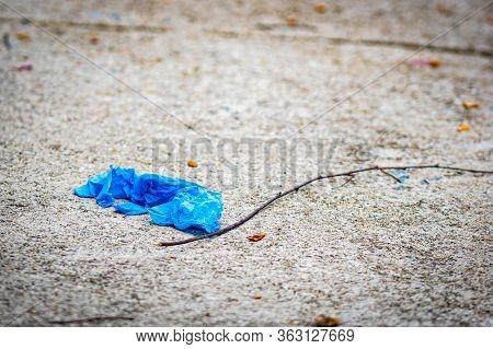 Blue Protective Gloves On Sidewalk During Corona Virus Outbreak
