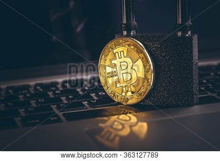 Bitcoin(btc) Coin With Padlock On Computer Background. Bitcoin Security. Digital Cyber Safety Or Sec