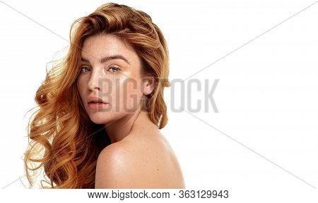 Ginger Young Woman With Natural Freckles.