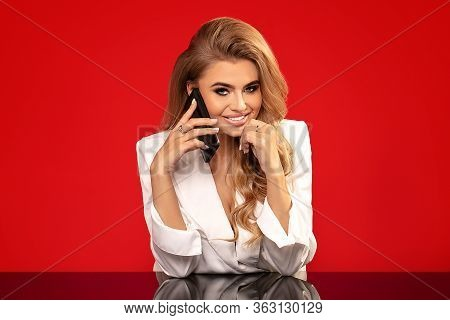 Elegant Smiling Lady With Mobile Phone.